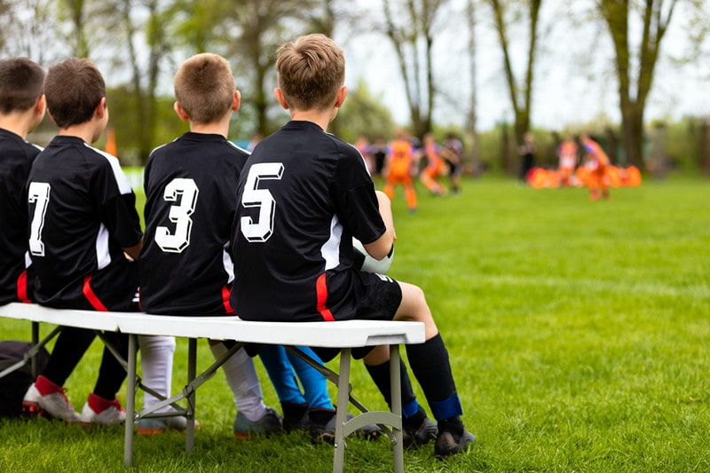How do I help my 10 years old son to deal with his unfair coach?